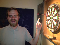 Mark Stephenson after throwing one dart into another dart